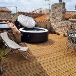 Terrasse sur les toits avec Jacuzzi