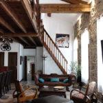 Salon Loft canapé fauteuils et table basse